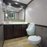 LUXURY 2 STATION PORTABLE RESTROOM TRAILER PICTURE URINAL